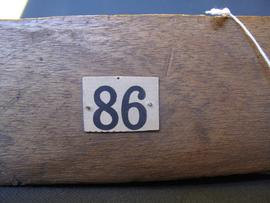 Brown paper label attached to object