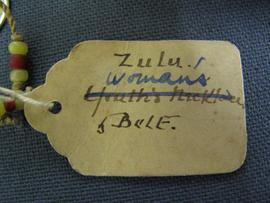 Oval paper label tied to object